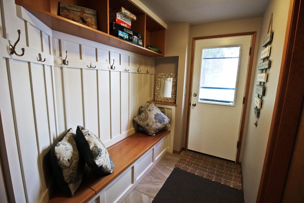 Lower level entry with built-in bench seat and coat hooks.