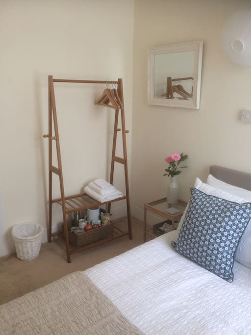 Hanging space, bedside table, mirror and an over bed light