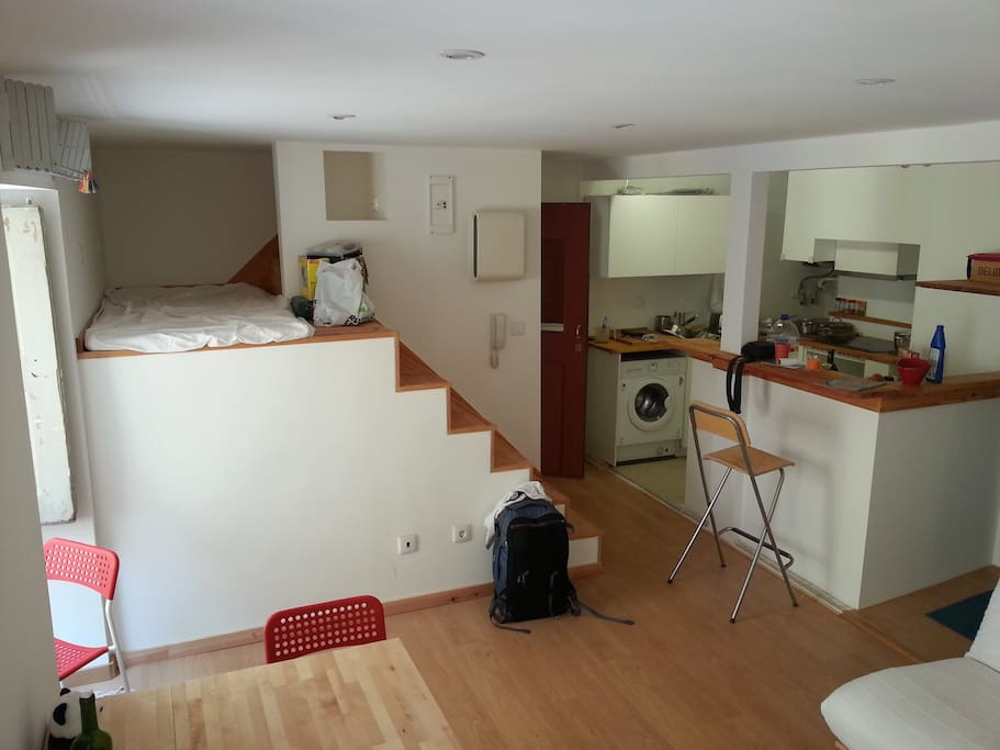 The third bed on the left and the open kitchen on the right, seen from the living room