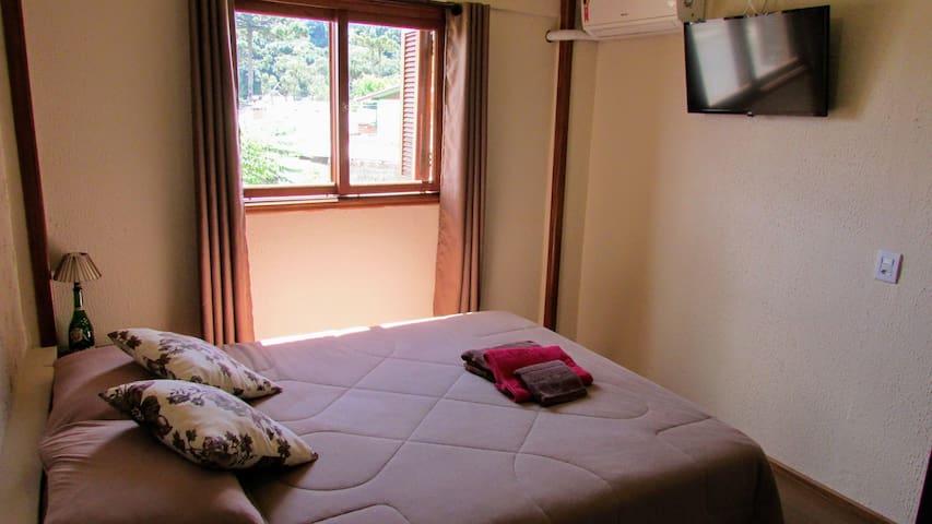 Apartamento com ar condicionado, wifi e cozinha