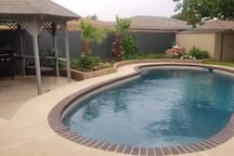 Backyard w gazebo, grill, and pool