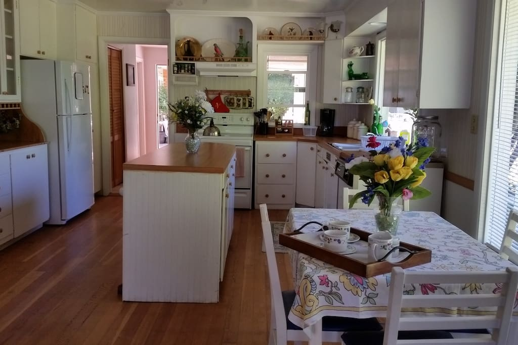 Country white kitchen - open concept, lots of counter and storage space