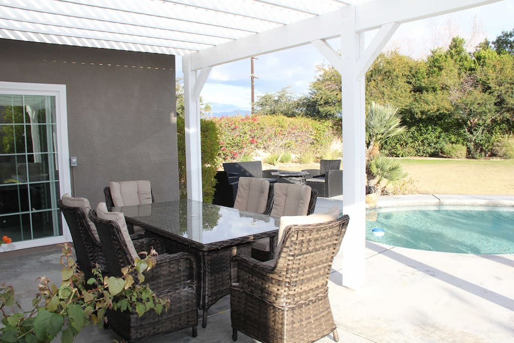 Outdoor dinning outside of kitchen French Doors - Fire pit can be seen in back ground