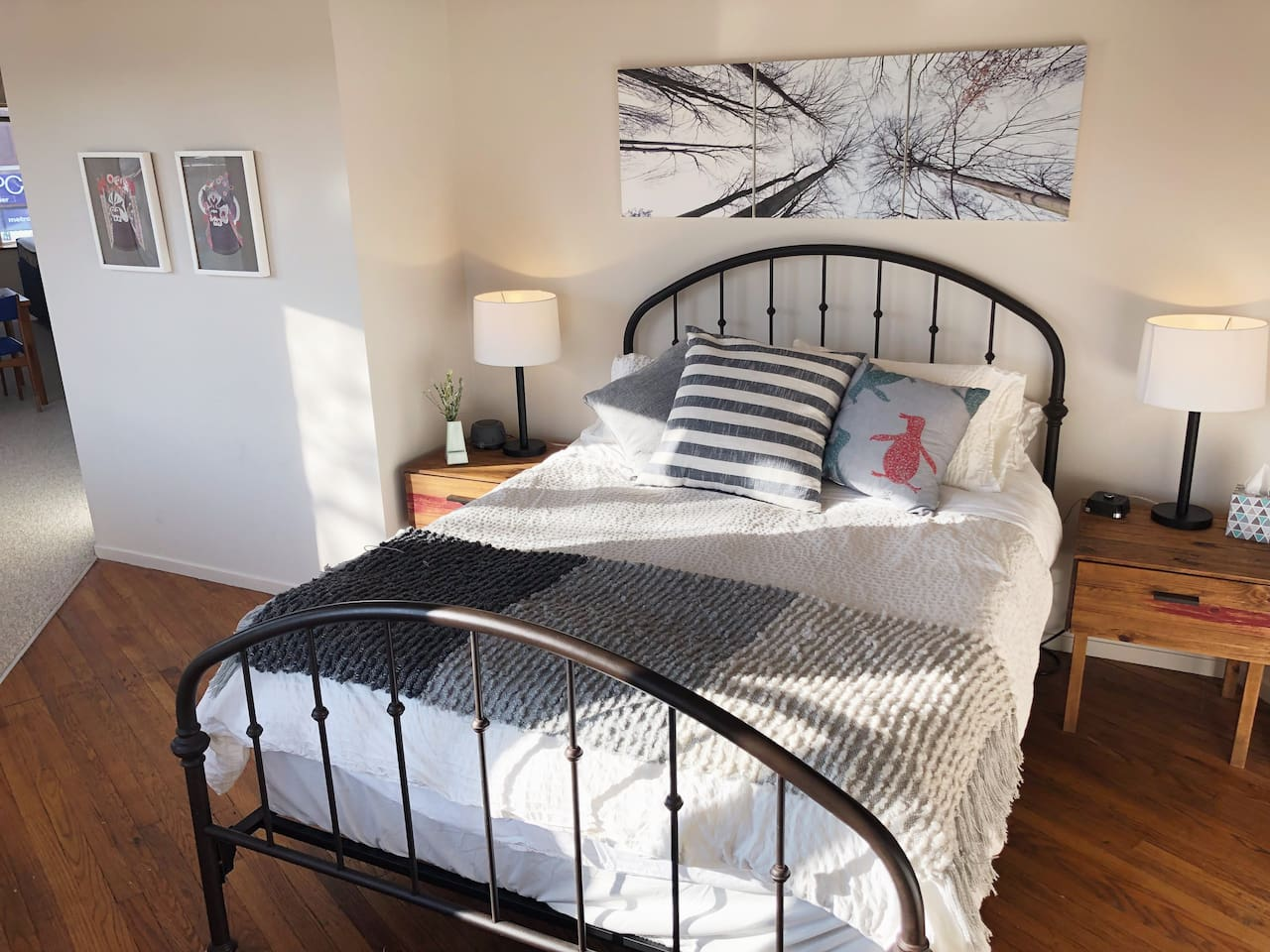Loft style bedroom with lots of natural light and black-out shades. Queen sized memory foam mattress, lots of pillows.  Working ceiling fan in the bedroom above the bed.  Bedside lamps for relaxing/reading.