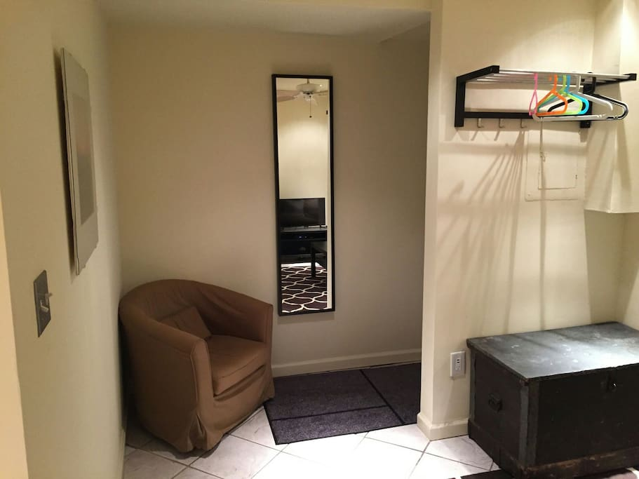 Entryway and full length mirror.