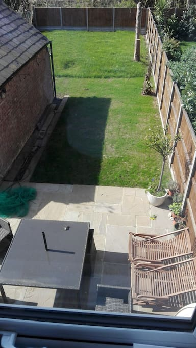 Sunny garden with seating and barbecue