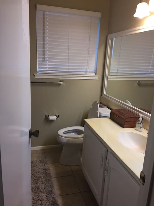 Clean bathroom with Tub and Shower