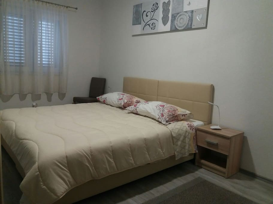 Bedroom with two comfortable beds that can be put together or separated.