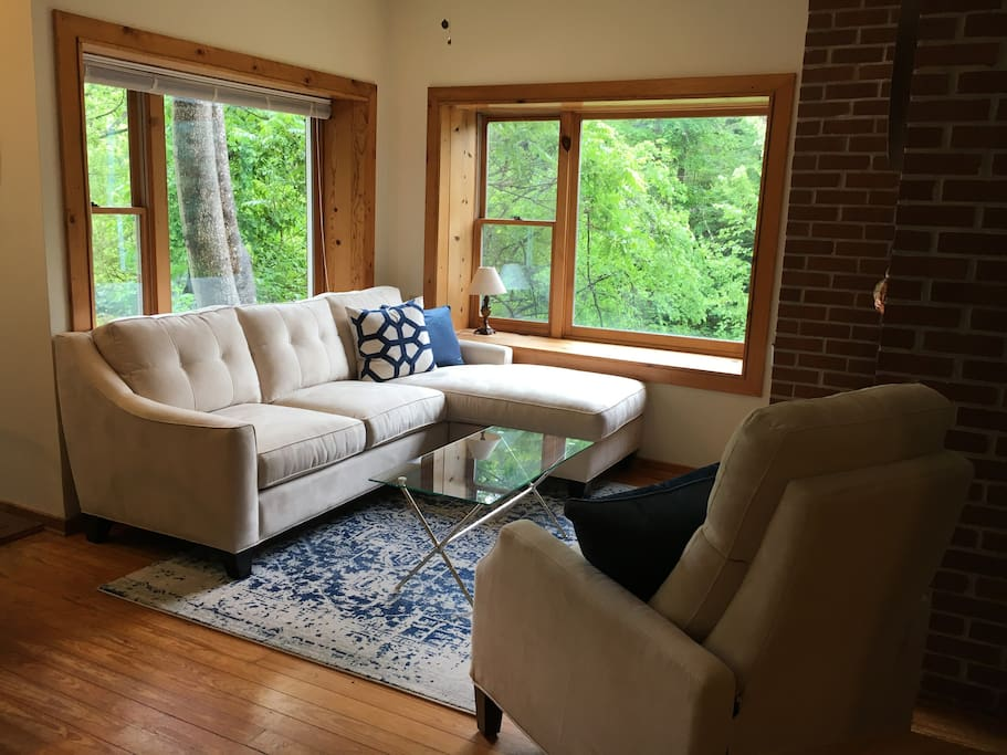 Living room with great picture windows with views of the water