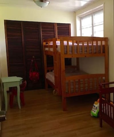 Bunker Beds and toddler bed with ceiling fan; playpen, air mattresses (twin and double) available if needed.