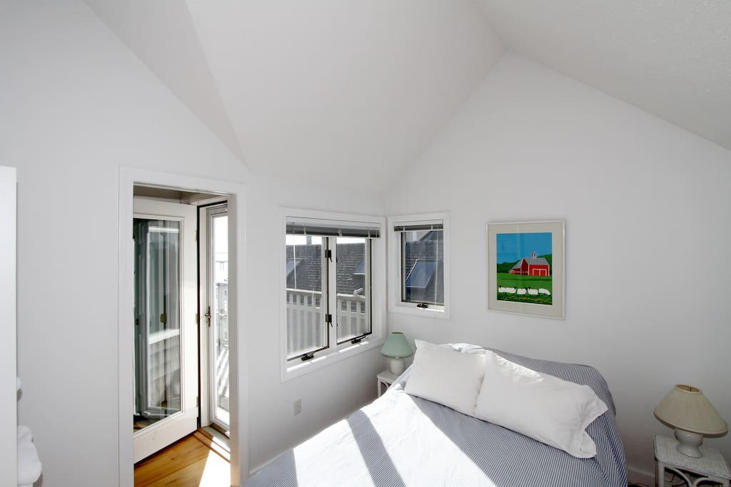 A full-sized bed and private deck is featured in the second bedroom.