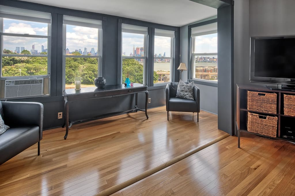 Living room with full views of NYC Skyline