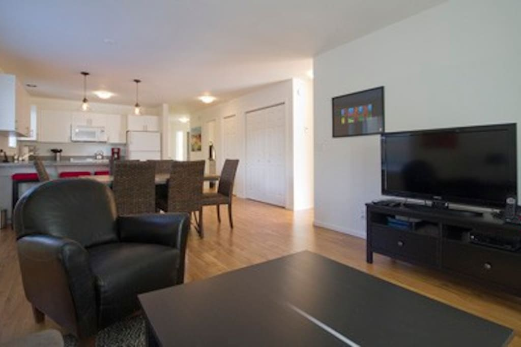 Living space has large flat screen LCD television with basic cable and DVD player