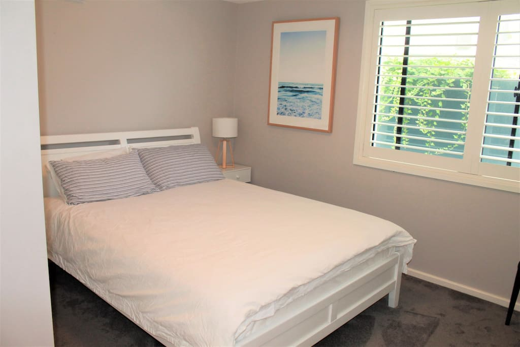 Queen bed in private bedroom. The bedroom is attached to the kitchenette and bathroom and is completely private and separate from the house.