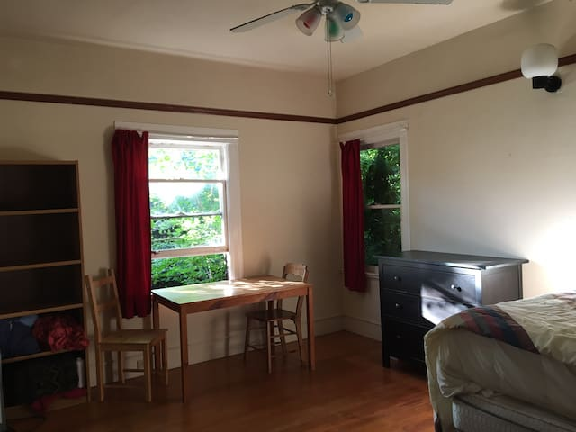 Beautiful bedroom surrounded by trees in Temescal!