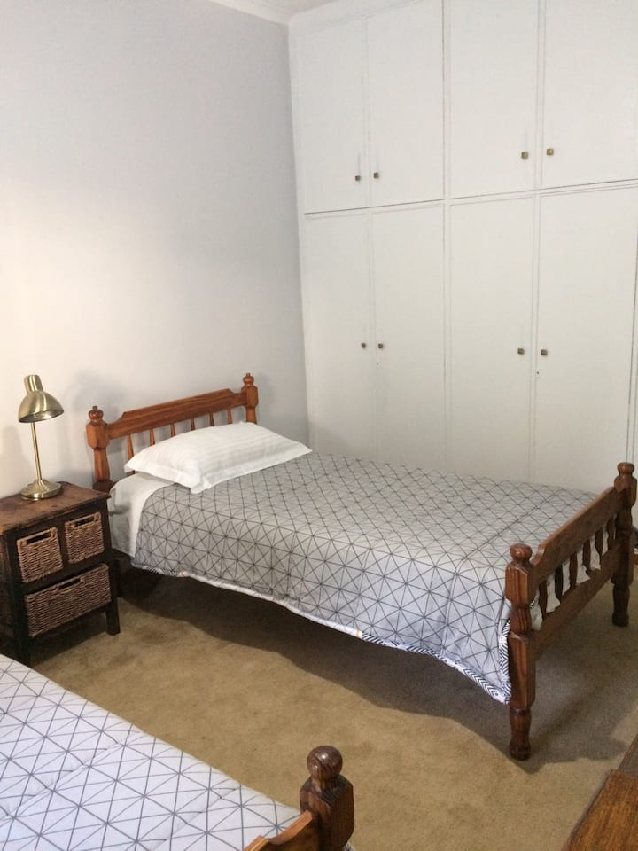 Two bedroom with lots of natural light