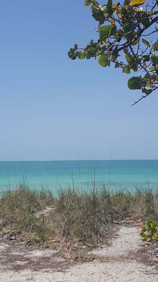 Just steps to the white sands of Lido Key - right at the snack bar/public beach