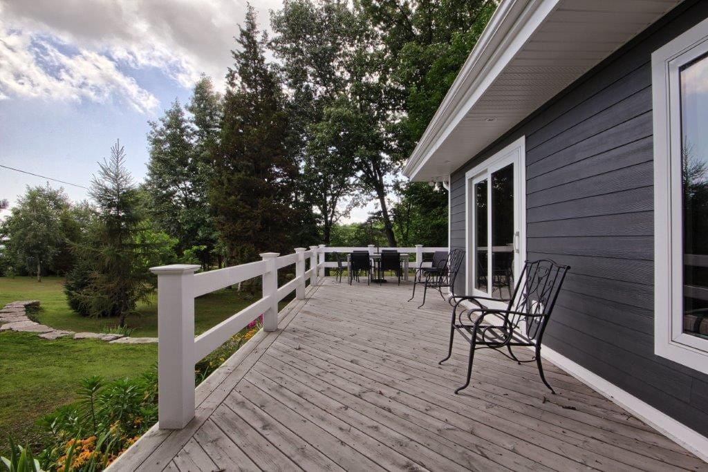 Large wraparound deck to enjoy lake breeze and the sun