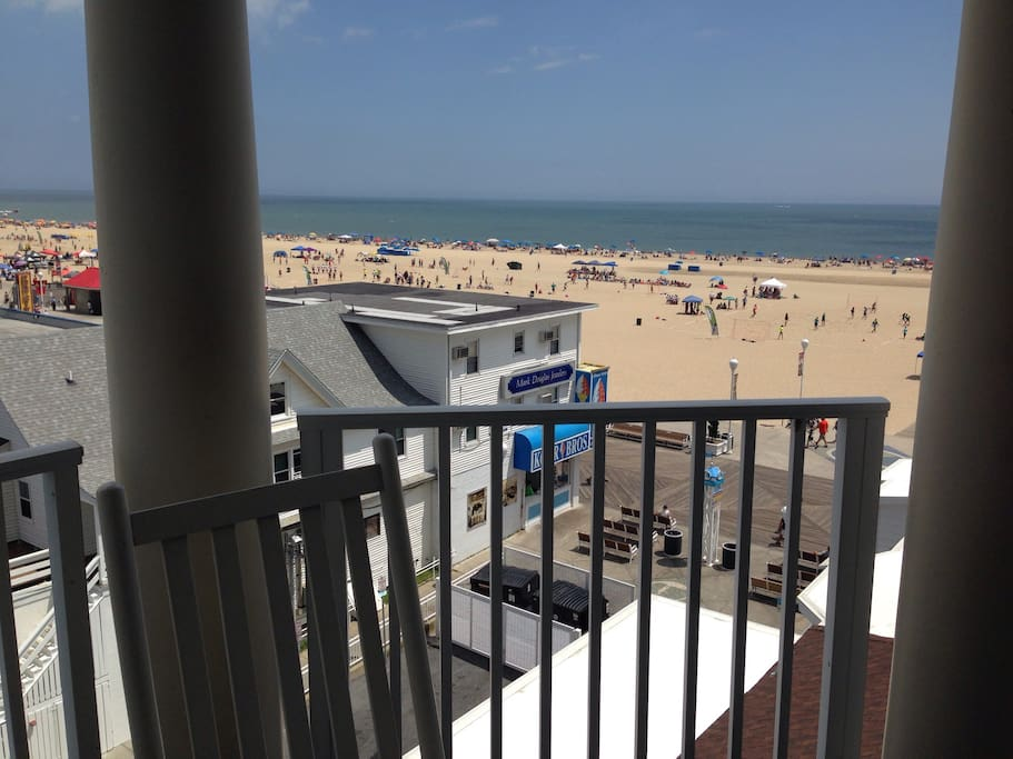 Balcony view of beach and boardwalk.