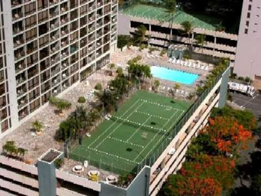 Beautiful pool area with tennis courts and BBQ on same floor as our unit yet down the hall so no pool noise
