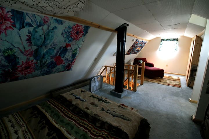 Upstairs. Bedroom and a reading spot.
