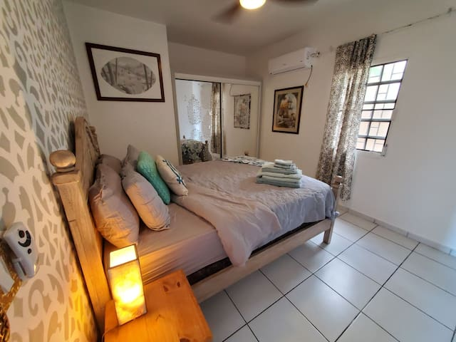 The second bedroom features a queen bed with beautiful and comfortable bedding.