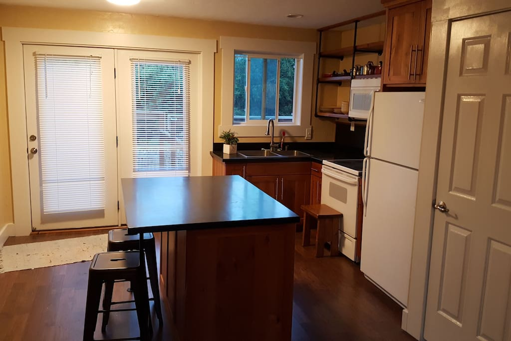 kitchen area, washer dryer are in the closet on the right