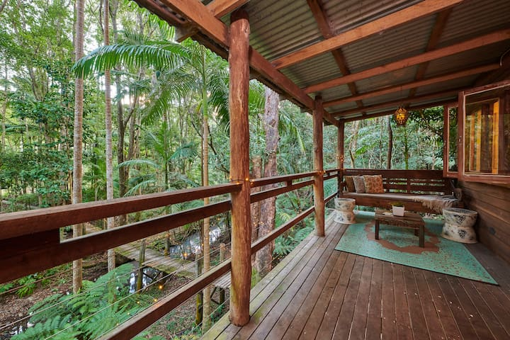 Sit amongst the treetops while listening to the gentle flow of the creek and the chorus of bird song.