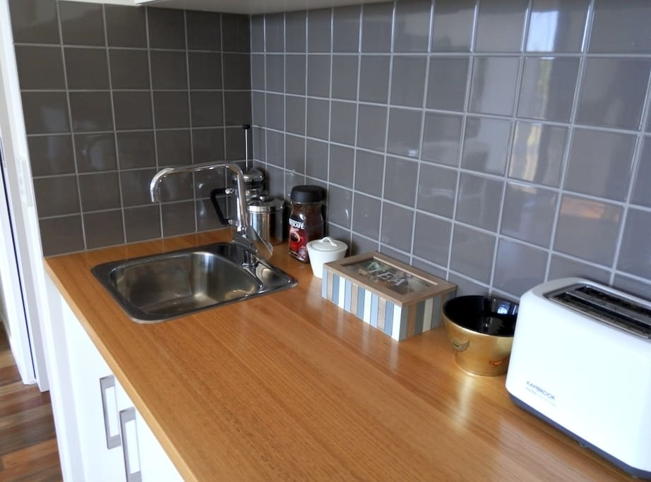 Kitchenette complete with kettle, sandwich maker, toaster and bar fridge. Instant or plunger coffee, tea, milk and sugar provided.