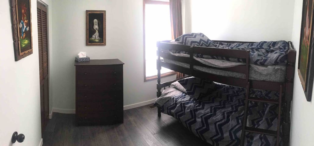 """""""Expressions"""". This lovely room is full of chocolate and coffee colors. Room darkening shades. Bunk beds. Dresser & closet. Blue tooth speaker enabled room light. Room for crib, play area for kids. Central to house to give privacy yet quick access."""