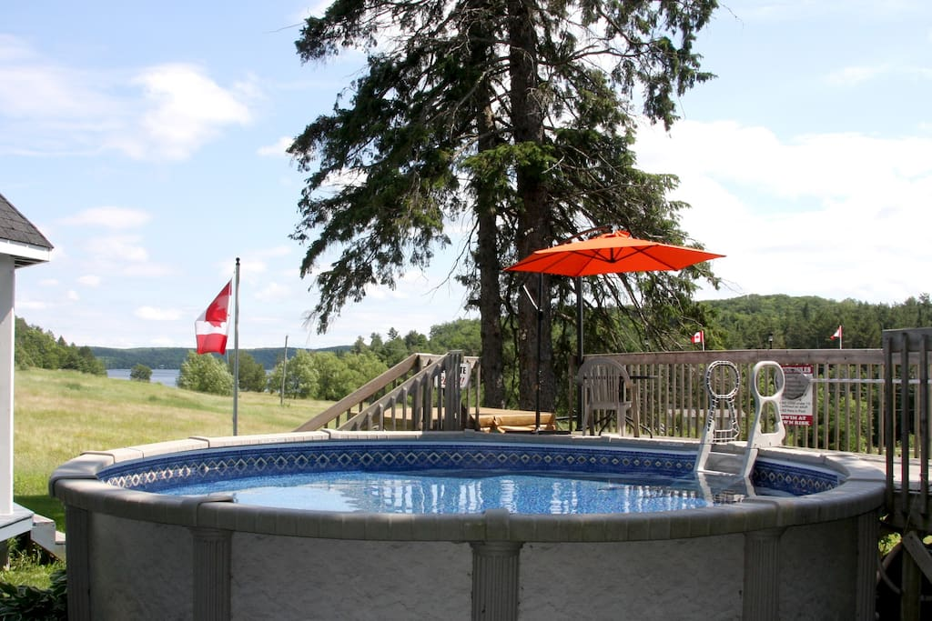 Pool, hot tub in background overlooking Mary Lake