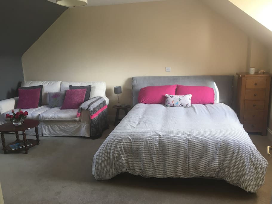 Comfortable king size bed in sunny room