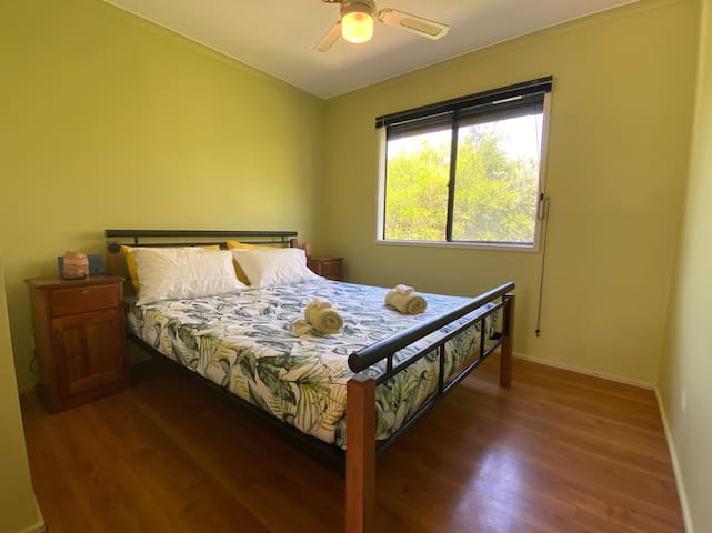 Master bedroom with queen bed and built-in robe