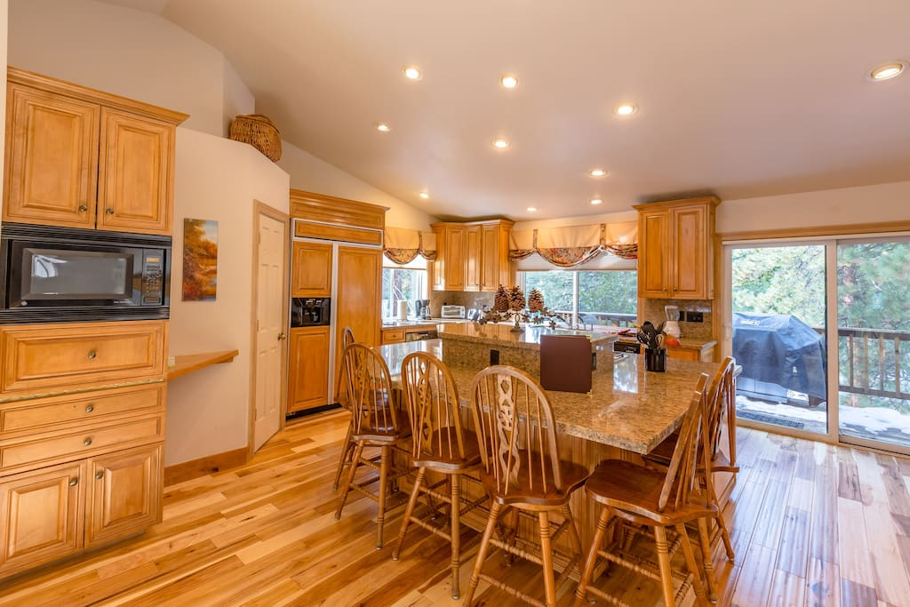 Large eat-in kitchen with 2 full-size ovens, 6 burner gas stove, Large fridge, Instant water and a walk-in pantry