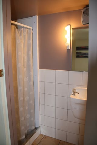 The bathroom (ensuite) contains shower cubicle, handbasin and toilet.