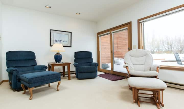 Centrally-located condo w/furnished deck, Teton views, wood fireplace, & more
