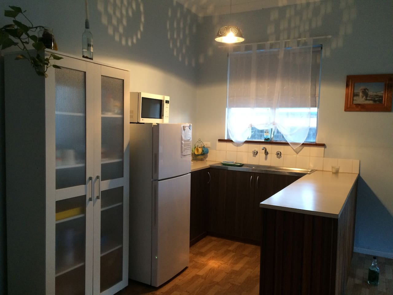 Kitchenette/dining table and  lounge. No stove ( BBQ out back ) microwave, electric frypan, small electric oven/ grill and toaster.