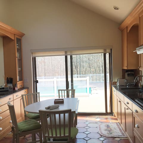 Eat in kitchen with stainless steel appliances and granite counter tops