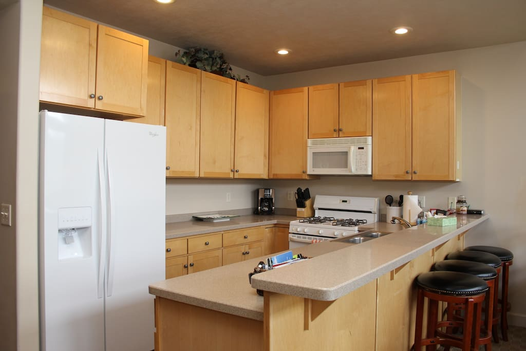 Fully Stocked Kitchen - Open to Living Spaces