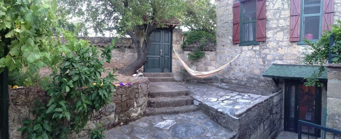 A Living Stone House in Adatepe