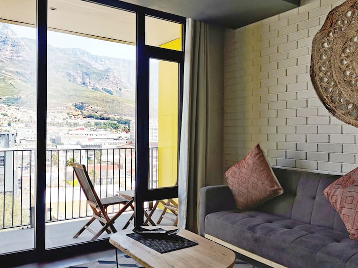 Designer top floor apartment with balcony