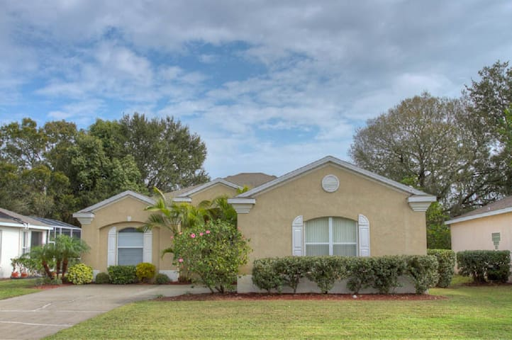 Comfortable Pool Home with Relaxing View of Backyard Pond: River Pointe 01
