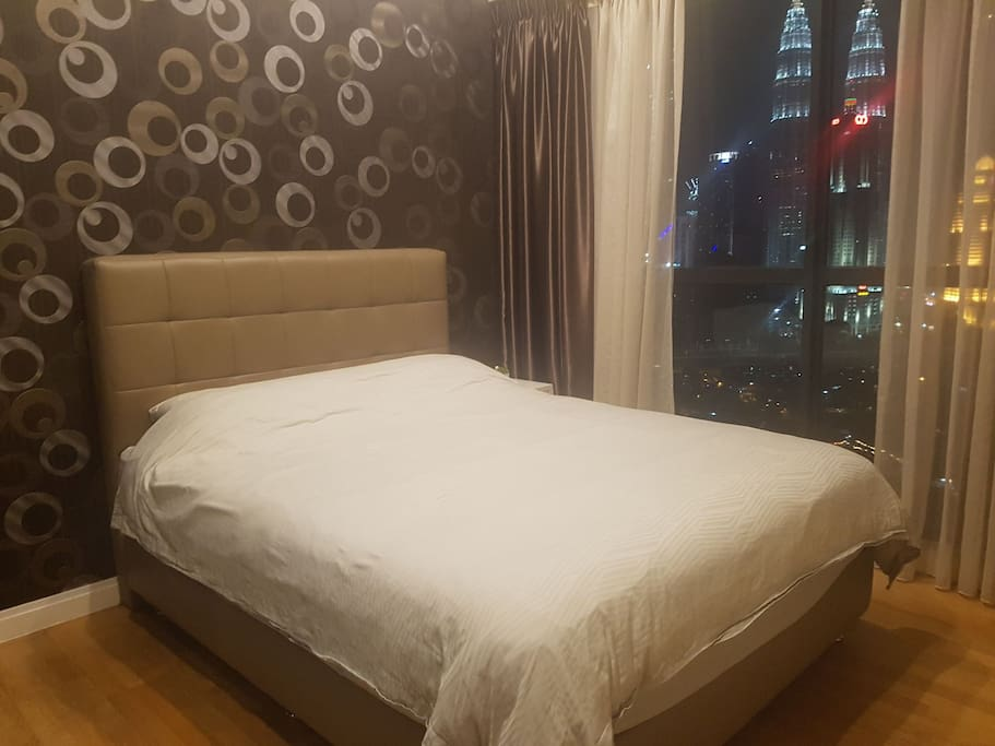 Comfortable Queen size bed with side table