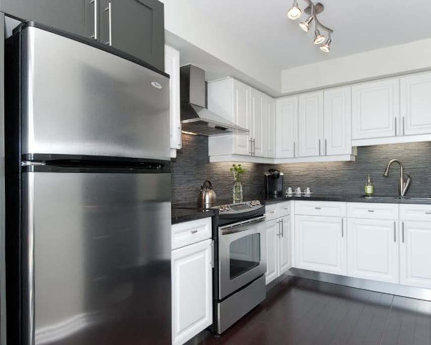Open-plan kitchen with all amenities