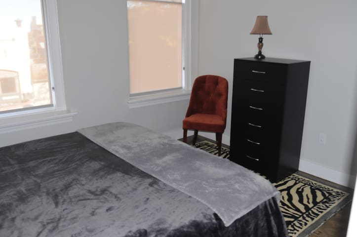 Huge windows overlooking Broad Street are one of our guests favorite things about this space!  Sit down and watch the world pass by while putting on your shoes. This room also has two huge closets
