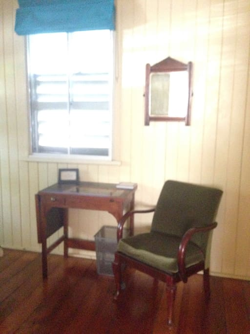 With a chair and desk