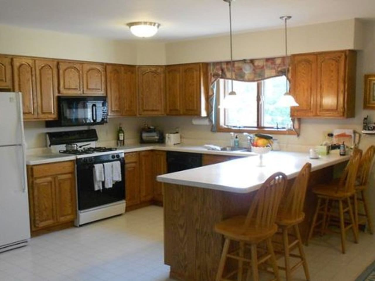 Full Kitchen stocked with all cookware and service for 8+.  Laundry Room is near kitchen with full size washer and dryer.