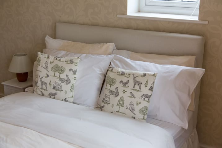 Comfortable double bed with French windows opening onto the terrace.