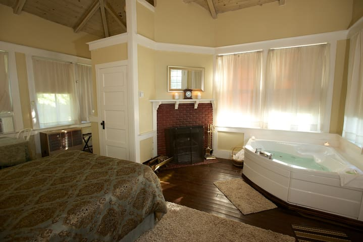 Private Cottage featuring double whirlpool tub and shower, fireplace, queen bed, refrigerator, microwave and coffeemaker.