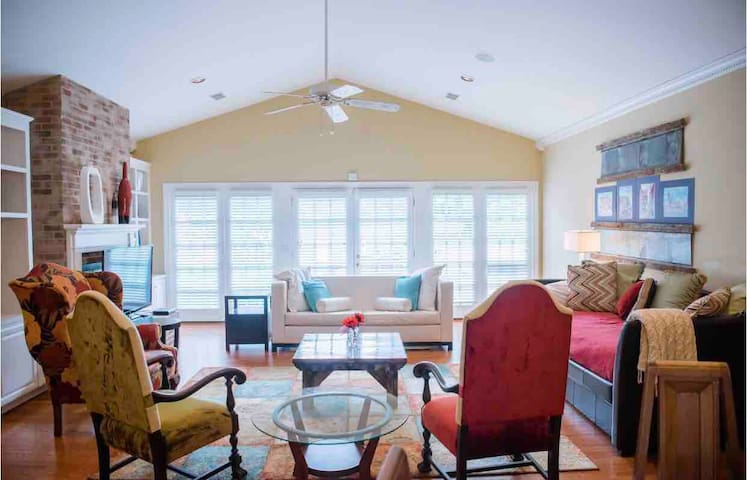 Lots of open space to hang out and enjoy each other's company! This  living room is open to the kitchen, dining room and back yard just through the French doors.